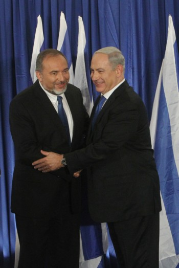 Israeli Prime Minister Benjamin Netanyahu, right, of Likud and Foreign Minister Avigdor Liberman of Yisrael Beiteinu holding a joint news conference announcing that their two parties are joining forces ahead of the upcoming Israeli general elections, Oct. 25, 2012.  (Miriam Alster/Flash90)