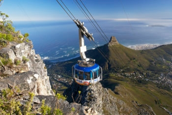 The cable car to Cape Town's Table Mountain, with Lion's Head Mountain in the background.  (Table Mountain Aerial Cableway)