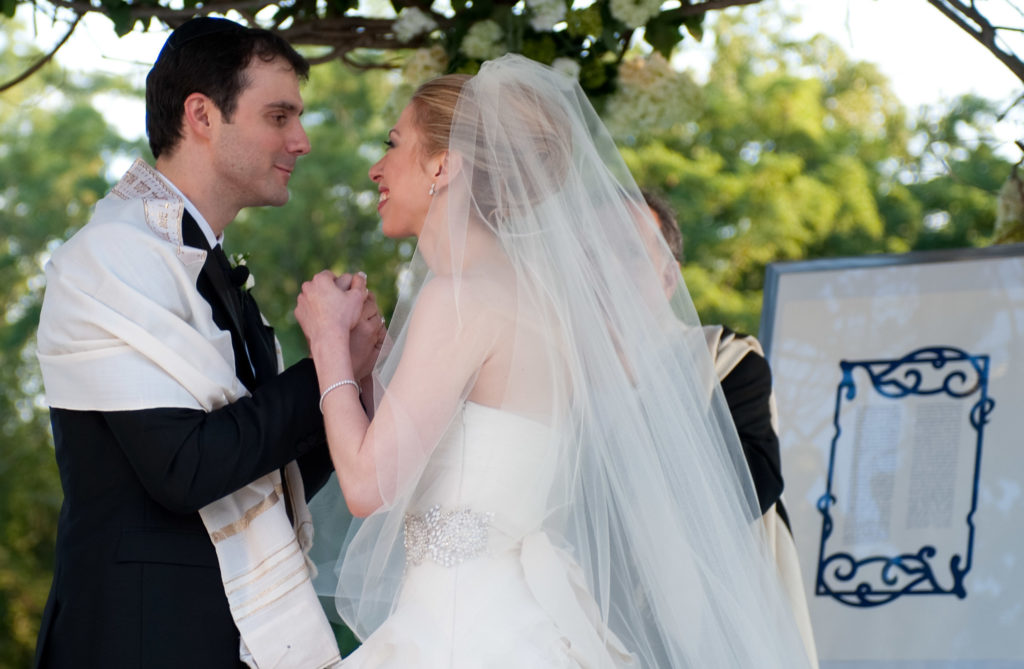 Without a national Jewish population study, finding how many Jews are marrying out of the faith will be difficult. The Marc Mezvinsky-Chelsea Clinton wedding seen here, from July 31, 2010, was one of the more notable interfaith weddings last year.  (Genevieve de Manio)