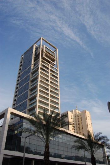 A luxury skyscaper near completion in central Tel Aviv, where prices are skyrocketing. (Dina Kraft)