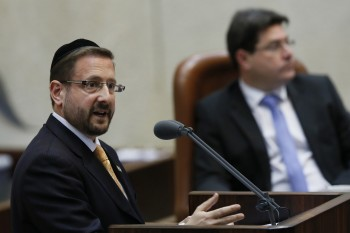 Dov Lipman, an American-born haredi Orthodox Knesset member for the centrist Yesh Atid party, speaking on the Knesset floor, March 2013. (Miriam Alster/Flash90)
