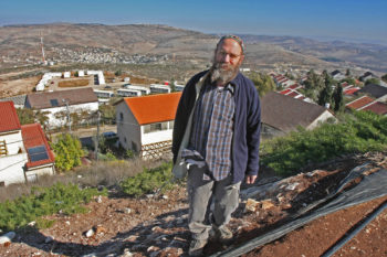 Yisrael Ariel stands overlooking the West Bank settlement of Yizhar on Dec. 11, 2008. (Brian Hendler)