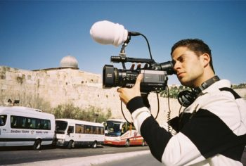 """Director Brandon Assanti checks camera angles while filming """"Their Eyes Were Dry"""" in Jerusalem in 2007.  (Albert Assanti)"""