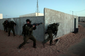 Israeli reservists taking part in an urban warfare exercise at a base in southern Israel in which they can simulate training as if they were fighting in the Gaza Strip or West Bank, October 2010.  (Tsafrir Abayov/Flash 90)