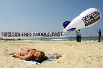 Greenpeace activists fly a zeppelin-shaped ballon over Tel Aviv coasts in 2007 to protest the nuclear threat in the Middle East, a concern the United States broached in its statement urging Israel to sign the non-nuclear proliferation treaty. (Chen Leopold/Flash 90/JTA)