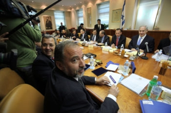 Foreign Minister Avigdor Lieberman, foreground, seen at a Cabinet meeting on April 26, 2009, has been at odds with Defense Minister Ehud Barak, to his left, over negotiating with Syria. (Yossi Zamir / Flash90 / JTA)