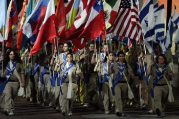 Flag-bearing participants at the opening ceremonies of the18th Maccabiah Games show off the countries they represent as they march into Ramat Gan Stadium on July 13, 2009. (Uri Lenz / Flash90 / JTA)
