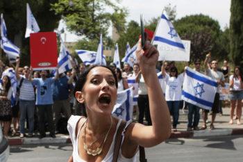 An Israeli student brandishes her identity card in a demonstration outside Jerusalem's Hebrew University in support of the Israeli Navy raid on ships bound for Gaza, June 1, 2010. (Kobi Gideon / Flash90)