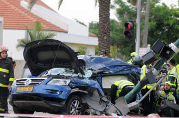One person was killed and more than a dozen wounded after an Arab Israeli truck driver rammed his vehicle into cars and pedestrians in a suspected terrorist attack in Tel Aviv, May 15, 2011. (Yossi Zeliger/Flash90)