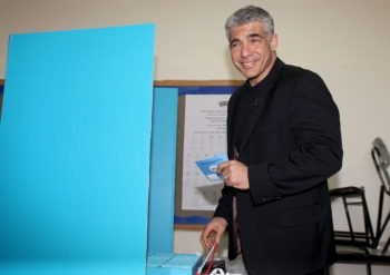 Yair Lapid, head of the Yesh Atid party, casting his vote in Tel Aviv during the general elections for Israel's 19th parliament, Jan. 22, 2013. (Gideon Markowicz/Flash90)