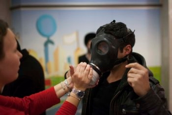 Israeli postal workers distribute gas masks to Jerusalem residents amid warnings of chemical weapons used by both sides in the Syrian civil war, Jan. 30, 2013. (Yonatan Sindel/Flash90)