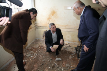 NRWA Commissioner-General Filippo Grandi visiting a classroom that had been hit by shelling at al-Faloujeh school, Yarmouk camp, Syria, December 2012.  (UNRWA)