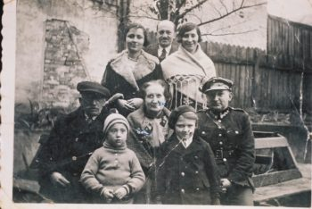 The family of Arnold Greenfeld, Hava Shilo's father, is shown in this 1932 image taken next to their home in Lvov. All eight people were killed in the Holocaust.  (Courtesy Hava Shilo)
