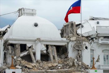 A Haitian flag flies over the ruins of Haiti's presidential palace in Port-au-Prince, destroyed in the Jan. 12 earthquake. (Larry Luxner)
