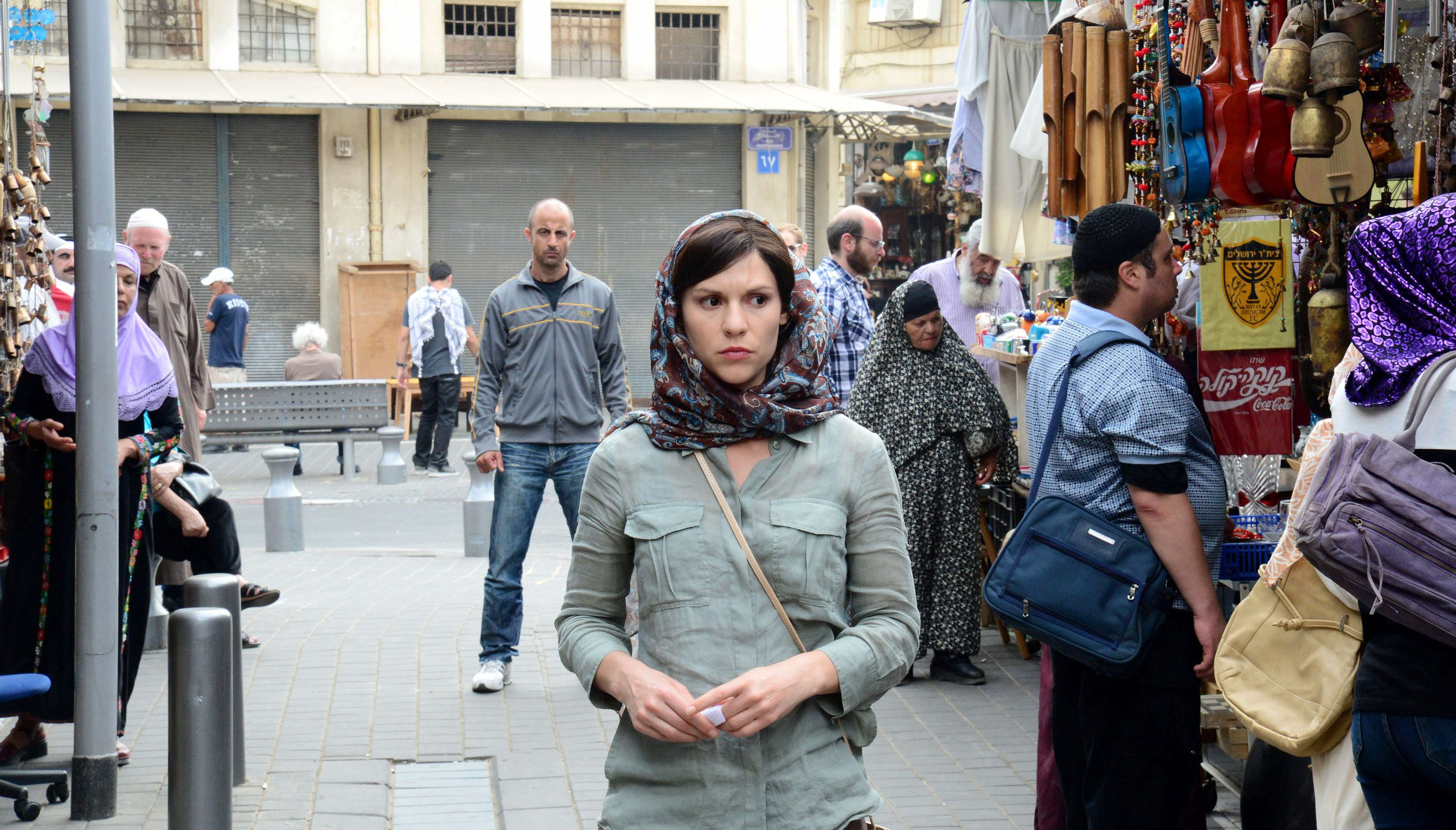 "A scene from ""Homeland"" showing Claire Danes as a CIA agent walking around in ""Beirut,"" which was shot in Tel Aviv, as some Hebrew artifacts can be seen on the right side of the photo. (Showtime)"