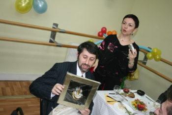 Galina Rybnikova, with camera at a Moscow Jewish center event on March 17, 2009, says she is optimistic about her future despite the challenges wrought by tough economic times. (Grant Slater)