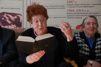 Khava Yavitz, 77, reads from a copy of the collected works of Shalom Aleichem in Birobidzhan's Jewish community center. (Grant Slater)