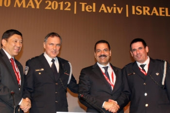 Left to right, Interpol President Khoo Boon Hui, Israeli police chief Yohanan Danino, and Interpol officials Ronald Kenneth Noble and Yoav Segalovitz, at the international police organization's European Regional Conference in Tel Aviv, May 8, 2012.  (Gideon Markowicz/Flash90)
