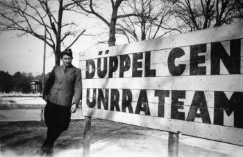 An unidentified young man standing outside the Duppel DP Camp at Schlachtensee in Berlin, 1946/47.  (Courtesy Ariane Joachim)