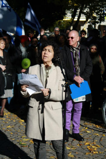 Lena Posner-Korosi, president of the Council of Swedish Jewish Communities, speaking at a rally at Stockholm's Raoul Wallenberg Park in solidarity with the Malmo Jewish community, Oct. 7, 2012. (Annika Hernroth-Rothstein)