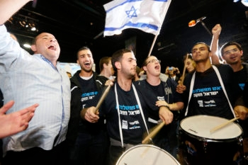 Likud-Beitenu supporters cheering after hearing the results of exit polls on the Israeli elections, Jan. 22, 2013.  (Miriam Alster/FLASH90)