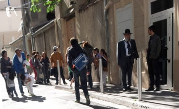 Members of Marseille's Jewish community outside the city's Great Synagogue, Oct. 15, 2012. (Cnaan Liphshiz)