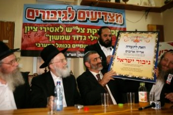 Michael Ben-Ari of the hard-line National Union Party holds a certificate that honors Israeli soldiers who refused to evacuate the Jewish settlement of Homesh in the West Bank, Nov. 11, 2009. (Miriam Alster / FLASH90 / JTA)