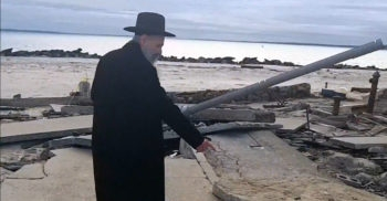 Chasidic singer Mordechai Ben David showing the damage afflicted by Sandy to the Sea Gate community in Brooklyn. (SGSandy via YouTube)