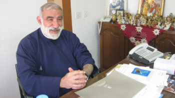 """The Rev. Emil Shoufani, in his office at the St. Joseph's School in Nazareth, says Christians in Israel """"are looking for quiet and stability."""" (Dina Kraft)"""