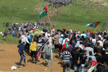 """Arab demonstrators marking the 63rd anniversary of the Nakba, the term meaning """"catastrophe"""" that Arabs use to describe the creation of the State of Israel, approaching a Golan Heights village, May 15, 2011. Photo by  (Hamad Almakt/ Flash90)"""