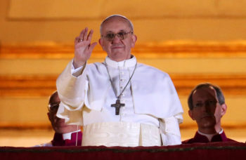 Newly elected Pope Francis I waving to the crowds on the central balcony of St. Peter's Basilica in Vatican City, March 13, 2013. (Peter Macdiarmid/Getty)