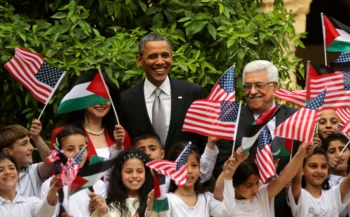 President Obama and Palestinian Authority President Mahmoud Abbas taking pictures with Palestinian children during a visit to the Church of the Nativity in Bethlehem, West Bank, March 22, 2013.  (Atef Safadi/Getty)