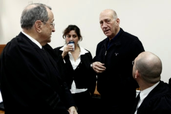 Former Israeli prime minister Ehud Olmert , pictured here in a Jerusalem court on Jan. 2, where he was on trial over alleged double-billing for travel expenses, now faces new charges regarding a real estate scandal. (Uri Lenz/Flash 90)