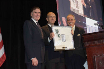Former Israeli Prime Minister Ehud Olmert is flanked by Seymour Reich, left, and Marvin Lender at the 2005 Israel Policy Forum annual dinner. (Courtesy IPF)