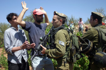 Israeli soldiers scuffling with Palestinians during a demonstration near the West Bank village of Beit Omar, Aug. 13, 2011. Some analysts have warned that a U.N. vote on Palestinian statehood could set off a new wave of Palestinian-Israeli violence. (Najeh Hashlamoun / Flash 90)