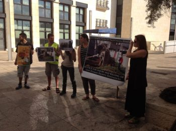 Anti-occupation activists demonstrate outside the Haifa District Court in advance of the verdict on whether Israel was responsible for activist Rachel Corrie's death in 2003, Aug. 28, 2012.  (Ben Sales)
