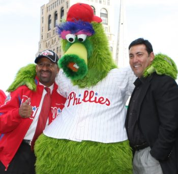 Ruben Amaro Jr., right, the general manager of the Philadelphia Phillies, joins Mayor Michael Nutter and the team's mascot at a pep rally in Philadelphia during the playoffs in 2009. (Darryl W. Moran)