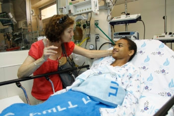 Laura Kafif, the house mother at Save A Child's Heart, visits with one of her charges, Zeresenay Gebru, as he recovers from heart surgery at Wolfson Medical Center in Holon, Israel, May 31, 2011. (Sheila Shalhevet )