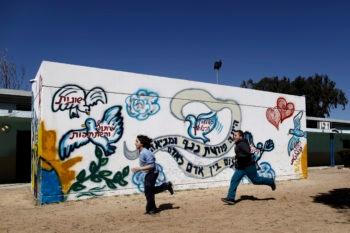 Israeli students running by a bomb shelter at an elementary school in the coastal city of Ashkelon, March 18, 2012. (Tsafrir Abayov/Flash90)