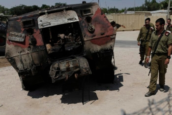The wreckage of an Egyptian military vehicle after militants burst through a security fence into Israel at a military base along its Egyptian border, Aug. 6, 2012. (Tsafrir Abayov/Flash90)