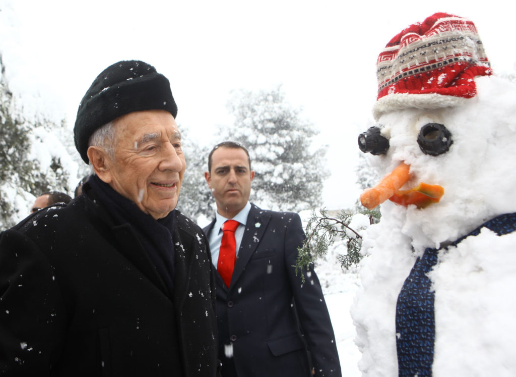 Israeli President Shimon Peres and a snowman in the garden of Peres' residence, Jan. 10, 2013.  (Kobi Gideon/GPO/FLASH90/JTA)