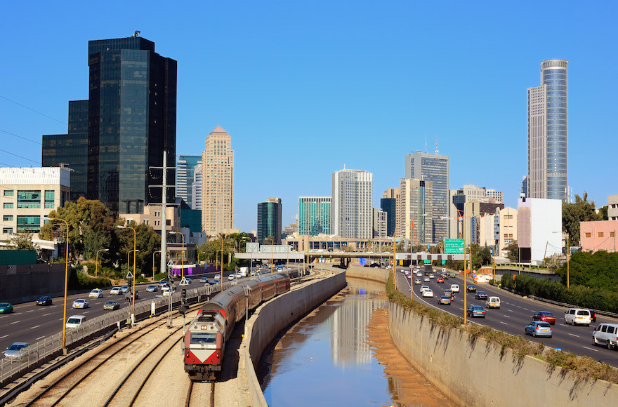 Israeli train riding through Ramat Gan's financial district. (Shutterstock/JTA)