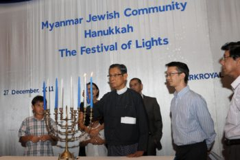 U Tin Oo, a former commander-in-chief of Myanmar's army, lights a candle at the Chanukah celebration in Yangon, Myanmar, Dec. 27, 2011. (Sammy Samuels)
