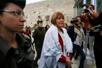 Lesley Sachs, director of Women of the Wall, is detained by police after wearing a prayer shawl at the Western Wall in Jerusalem, April 11, 2013. (Miriam Alster/Flash90)