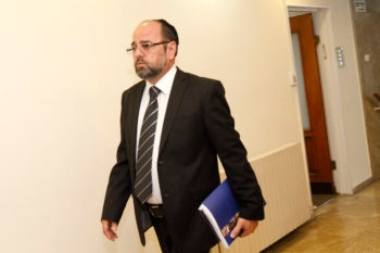 Religious Services Minister Yaakov Margi, a member of the haredi Orthdox Shas party, arriving for the weekly Cabinet meeting at the Prime Minister's office in Jerusalem, June 19, 2011. (Miriam Alster/FLASH90 )