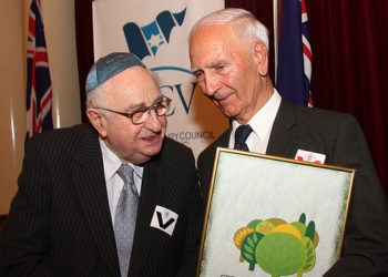 """Shmuel Rosenkranz, left, a survivor of Kristallnacht who lost 32 family members in the Holocaust, with Alfred """"Boydie"""" Turner, the grandson of William Cooper. (Peter Haskin) ()"""