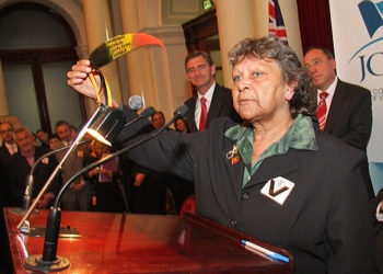 Ella Anselmi holds a eucalyptus leaf decorated in the colors of the Aboriginal flag with Israeli Ambassador Yuval Rotem's name inscribed on it. (Peter Haskin) ()