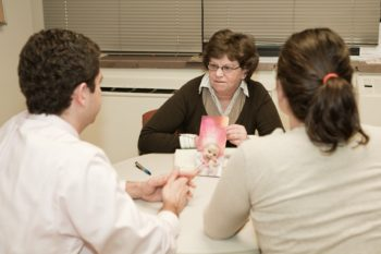 Adele Schneider, M.D., of the Victor Center, counseling a couple. (Victor Center)