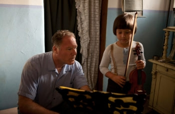 "Director Josh Aronson instructing Henk Reinicke as little Broni Huberman in the Oscar-nominated filmmaker's documentary ""Orchestra of Exiles.""  (Irina Tubbecke)"
