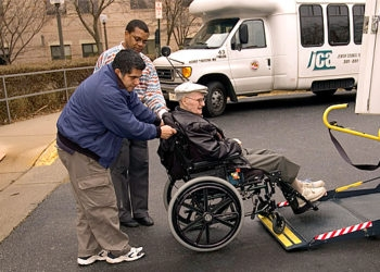 A passenger is helped onto an Elderbus, a program run by the Jewish Council for the Aging of Greater Washington whose funding could be jeopardized by losses suffered in the Madoff scandal.  (Washington Jewish Week)